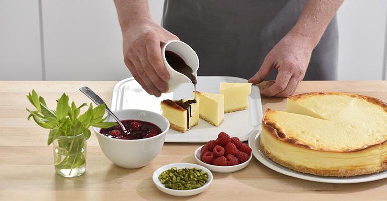 ganache de chocolate sobre tarta de queso